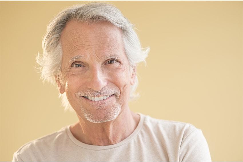 mature man with unique smile